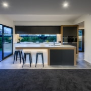 ​​​​​​​With glass slider beside and glass splashback behind,