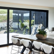 ​​​​​​​The choice of black window joinery helps frame