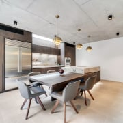 ​​​​​​​This material-rich kitchen by Thinkdzine features Italian smoked