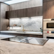 ​​​​​​​With recessed pulls, the refined cabinetry in this