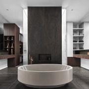 This symmetrical bathroom design puts the circular tub