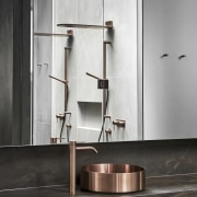 ​​​​​​​Copper finishes on stainless steel tapware and basins