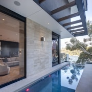 The cantilevered pool literally adopts space as its