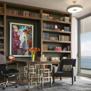 The library/study with its subtle Asian references has architecture, bookcase, building, ceiling, furniture, home, house, interior design, living room, room, shelf, shelving, table, wall, black, gray