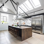 The kitchen is bathed in natural light, courtesy