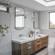 Large-format marble-look tiles are matched with a feature