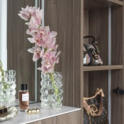 Display storage features alongside the wood-finished make-up station.