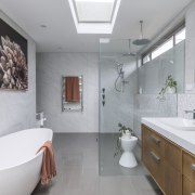 Rich finishes, a freestanding tub and furniture-like vanity