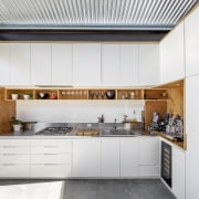The home's white and wood kitchen. - Limited