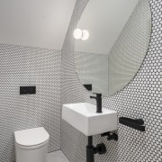 A contemporary powder room in the home makes