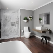 ​​​​​​​This bathroom by Plumbing World captures the architecture, bathroom, bathroom accessory, floor, home, interior design, plumbing fixture, room, sink, tap, wall, gray
