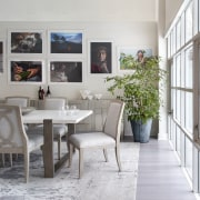 The pale-toned dining area is injected with pops