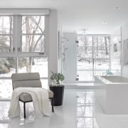 The master ensuite includes an inviting, free-standing tub.