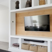 Natural elements feature throughout the white, wood and
