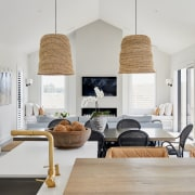 The jute pendants over the dining table were