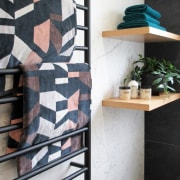 The timber floating shelves – along with the white, black
