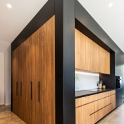 Demure cabinetry conceals a wealth of integrated appliances