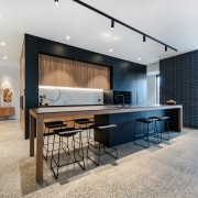 The kitchen's, moody black cabinetry and Tuscan Oak