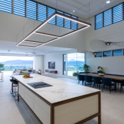 A rectilinear light pendant echoing the shape of