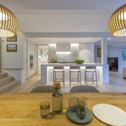 The new kitchen is now a centrepiece of architecture, building, ceiling, ceiling fixture, daylighting, estate, floor, furniture, home, house, interior design, light fixture, lighting, living room, lobby, loft, property, real estate, room, table, wood, gray