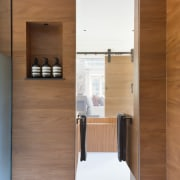 Floor-to-ceiling switchable privacy glass gives a visual connection