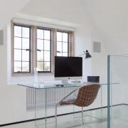 The glass-floored, mezzanine-level study enjoys spectacular views of