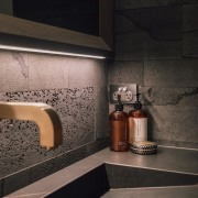 Natural elements like the bluestone feature walls, Neolith