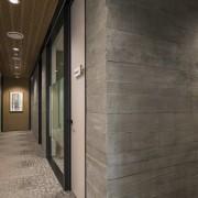 The building has an exposed precast concrete panel