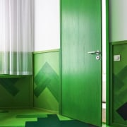 As part of the design, the architects took architecture, door, floor, glass, green, interior design, line, material property, plumbing fixture, restroom, room, toilet, vehicle door, wall, green, white
