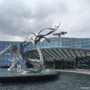 Sculpture in front of the entrance lobby at architecture, art, fountain, sculpture, water, water feature, white
