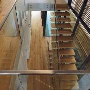 Roar Northcurlcurl House 35S architecture, daylighting, floor, flooring, glass, handrail, hardwood, stairs, wood, brown, gray