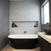 Your motivation for renovating will impact the decisions architecture, bathroom, bathroom accessory, bathtub, bidet, ceramic, floor, flooring, interior design, plumbing fixture, property, room, sink, tap, tile, toilet, wall, black, gray
