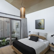 The indoor garden separates the master suite from