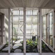 The home's sheltered indoor garden separates the master