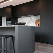 The kitchen has a granite benchtop, marble statuario