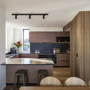Wood also features in the family kitchen. -