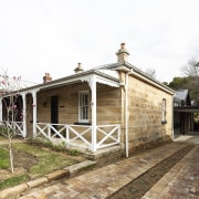 The addition to the sandstone cottage is in