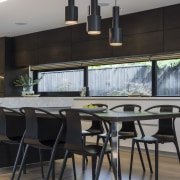 Kitchen by Eterno Design - Kitchen by Eterno chair, dining room, furniture, interior design, kitchen, table, gray, black