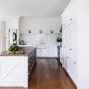 The wood cabinetry and benchtop on the island