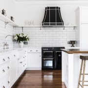 The kitchen has a spacious feel and includes