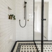 The spacious shower stall includes a slide shower gray