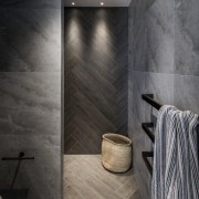 The feature tiling, in a striking herringbone pattern,