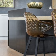 The dining chair frames complement the black elements