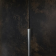 Understated handles meet subtle feature cabinetry surface.