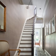 The walls are painted to resemble thin silk, architecture, ceiling, daylighting, handrail, home, house, interior design, real estate, stairs, wall, gray