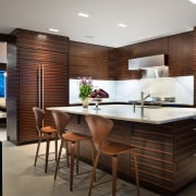 The wood used in the kitchen is ebony, cabinetry, countertop, interior design, kitchen, black, gray