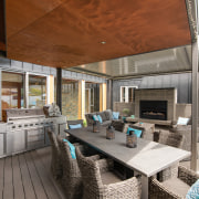A substantial barbecue and generous dropped ceiling-defined dining