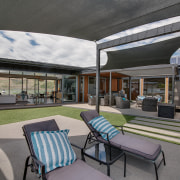 Shade sails provide sun protection while the home