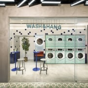 Wash & Hang takes on a more social building, design, eyewear, interior design, room, gray, white