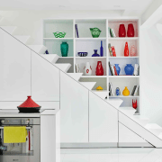 The cupboards under the stairs hold kitchen appliances furniture, interior design, product, shelf, shelving, white